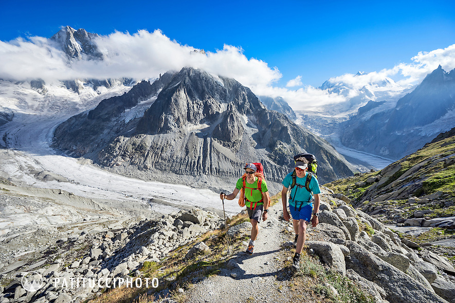 Two climbers hiking uphill on their way to the Couvercle Hut, Chamonix, France