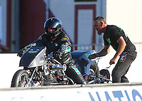 Jun 3, 2016; Epping , NH, USA; NHRA top fuel Harley motorcycle rider Tracy Kile with crew member during qualifying for the New England Nationals at New England Dragway. Mandatory Credit: Mark J. Rebilas-USA TODAY Sports