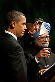 Washington, DC - November 24, 2009 -- United States President Barack Obama, left, and Manmohan Singh, India's prime minister, propose a toast during the State Dinner on the South Lawn of the White House in Washington, D.C., U.S., on Tuesday, November 24, 2009. Obama welcomed India's role as a rising and responsible global power, saying the U.S. will follow through on a civilian nuclear agreement and work to expand trade and investment ties with the world's largest democracy. .Credit: Andrew Harrer - Pool via CNP