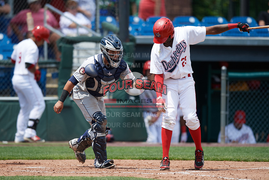 Mahoning Valley Scrappers catcher Gian Paul Gonzalez (4) tags Randy Encarnacion (25) to complete the strikeout during the first game of a doubleheader against the Auburn Doubledays on July 2, 2017 at Falcon Park in Auburn, New York.  Mahoning Valley defeated Auburn 3-0.  (Mike Janes/Four Seam Images)