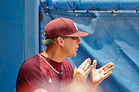 June 12, 2011:    Mississippi State Bulldogs head coach John Cohen cheers his team on from the dugout during NCAA Gainesville Super Regional Game 3 action between Florida Gators and Mississippi State Bulldogs played at Alfred A. McKethan Stadium on the campus of Florida University in Gainesville, Florida.  Florida defeated Mississippi State 8-6 to advance to the College World Series in Omaha, Nebraska........