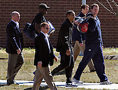 United States President Barack Obama (C, black tracksuit) walks with aides Reggie Love (rear, 2nd,L) and Marvin Nicholson (R) and his Secret Service detail as he departs the physical fitness building after a morning of basketball at the Fort McNair facility, to return to the White House in Washington, DC, USA, USA, Friday,  07 March 2010.  Obama is to make a statement on the elections in Iraq later in the day..Credit: Mike Theiler / Pool via CNP