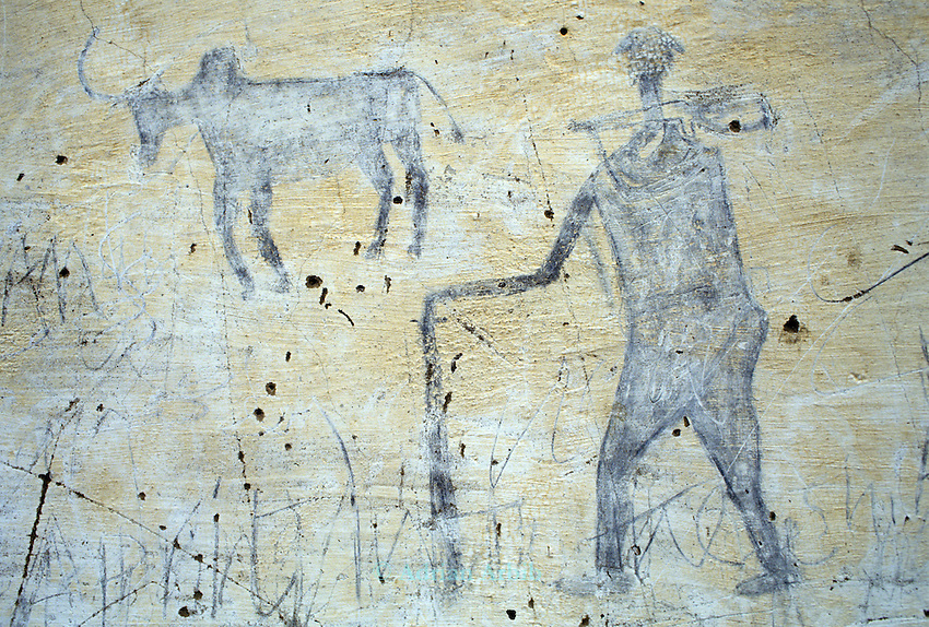 Drawings on a wall at Thiet feeding camp in Southern Sudan depict the ongoing war. Hundreds of Dinka tribes people having had their villages bombed and burnt  by the Khartoum forces  have travelled hundreds of miles to avoid  starvation a the feeding centre.