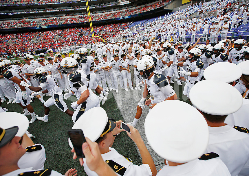 The Navy Midshipmen take the field before the college football game between the Ohio State Buckeyes and the Navy Midshipmen at M&T Bank Stadium in Baltimore, Saturday afternoon, August 30, 2014. The Ohio State Buckeyes defeated the Navy Midshipmen 34 - 17. (The Columbus Dispatch / Eamon Queeney)