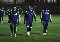 L-R: Neil Taylor, Leroy Lita and Marvin Emnes of Swansea arriving at the training ground
