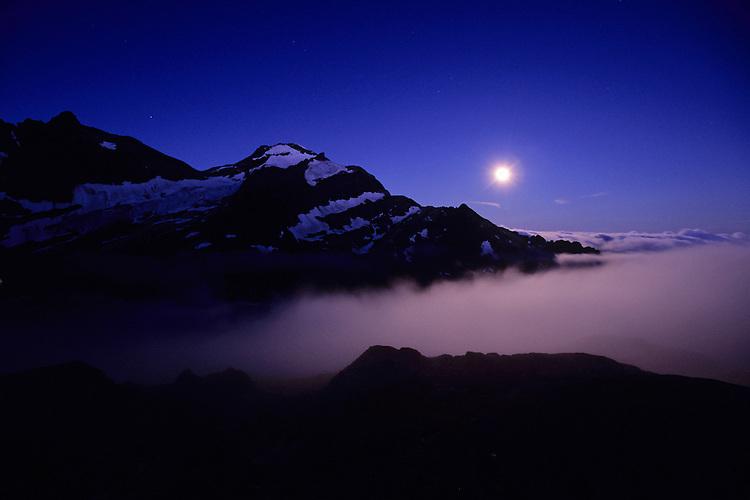 The moon sets behind Mont Tondu as the sun prepares to rise, Glacier de Tré-la-Tête, Mont-Blanc Massif, France, 2011.