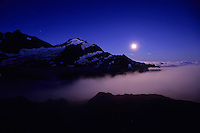 The moon sets behind Mont Tondu as the sun prepares to rise, Glacier de Tré-la-Tête, Mont-Blanc Massif, France, 2011.