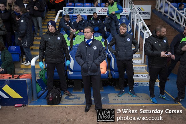 Peterborough United 1 Chesterfield 0, 21/03/2015. Abax Stadium, League One. Home club caretaker manager Dave Robertson taking his place in the dugout at the Abax Stadium, before Peterborough United play Chesterfield in a SkyBet League One fixture. The home team won the match by one goal to nil, watched by a crowd of 6,612. The result allowed Peterborough to leapfrog their opponents into the League One play-off positions with eight games remaining of the season. Photo by Colin McPherson.