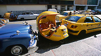 13 FEB 2003 - HAVANA, CUBA - One of Cubas cocotaxis parked between more conventional vehicles (PHOTO (C) NIGEL FARROW)