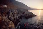 Crete, Greece, Sea Kayakers explore the southwest coast, Mediterranean Sea, Europe, Greek Orthodox chapel, Feathercraft breakdown aluminum and fabric sea kayaks, sunrise,