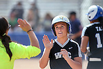 Western Nevada Head Coach Leah Wentworth high-fives Makaylee Jaussi after she scores against Southern Idaho at Edmonds Sports Complex in Carson City, Nev., on Friday, April 8, 2016. <br />