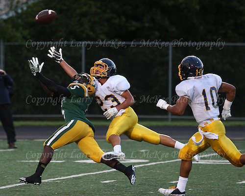 "Jackson Quinton (5), Farmington Hills Harrison attempts to catch a pass as Anthony Chavez-Moore (23), Oxford, attempts to break up the play during varsity football action at Harrison Thursday, Sept. 12, 2013. Oxford at Farmington Hills Harrison, Varsity Football, September 12, 2013. Photos: Larry McKee, L McKee Photography. L McKee Photography, Clarkston, Michigan. L McKee Photography, specializing in high school varsity action sports and senior portrait photography. Other L McKee Photography services include business profile, commercial, event, editorial, newspaper and magazine photography. Oakland Press Photographer. North Oakland Sports Chief Photographer. L McKee Photography, serving Oakland County, Genesee County, Livingston County and Wayne County, Michigan. L McKee Photography your ""professional"" source for high school varsity action sports and senior portrait photography."