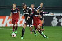 Washington, D.C.- March 29, 2014. Conor Doyle (30) of D.C. United goes against Mike Magee of the Chicago Fire.  The Chicago Fire tied D.C. United 2-2 during a Major League Soccer Match for the 2014 season at RFK Stadium.
