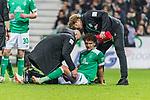 01.12.2018, Weserstadion, Bremen, GER, 1.FBL, Werder Bremen vs FC Bayern Muenchen<br /> <br /> DFL REGULATIONS PROHIBIT ANY USE OF PHOTOGRAPHS AS IMAGE SEQUENCES AND/OR QUASI-VIDEO.<br /> <br /> im Bild / picture shows<br /> Milos Veljkovic (Werder Bremen #13) verletzt am Boden, wird am Oberschenkel links behandelt von Adis Lovic (Physiotherapeut SV Werder Bremen) und Dr. Philip Heitmann (Mannschaftsarzt Werder Bremen), <br /> <br /> Foto &copy; nordphoto / Ewert