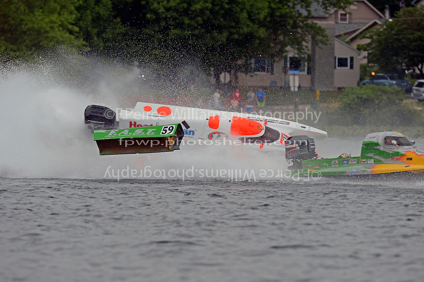 Frame 5: Mark Major (#17) races into the final turn and then tangles with Tyler Welch (#59) with Major's boat turning over.    (Formula 1/F1/Champ class)