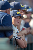 Michigan Wolverines pitcher Ben Keizer (14) in the dugout before Game 1 of the NCAA College World Series Finals on June 24, 2019 at TD Ameritrade Park in Omaha, Nebraska. Michigan defeated Vanderbilt 7-4. (Andrew Woolley/Four Seam Images)