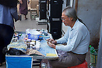 Marketer Using Cell Phone Near Gyee Zai Market