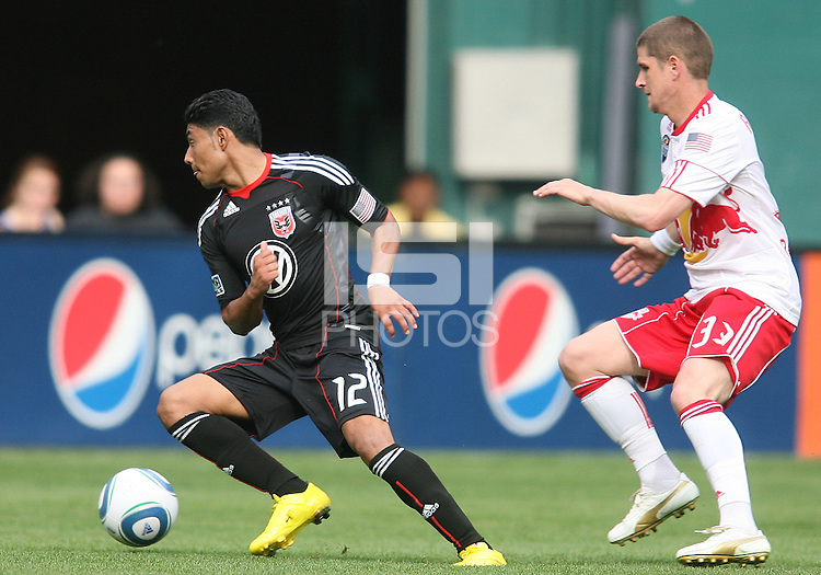 Cristian Castillo #12 of D.C. United cuts past Carl Robinson #33 of the New York Red Bulls during an MLS match on May 1 2010, at RFK Stadium in Washington D.C.