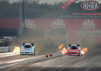 Aug. 31, 2012; Claremont, IN, USA: NHRA funny car driver Jack Beckman (left) races alongside Johnny Gray during qualifying for the US Nationals at Lucas Oil Raceway. Mandatory Credit: Mark J. Rebilas-