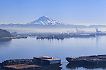 Shrouded in winter smog, once pristine Commencement Bay with Mount Rainier National Park  in the background, supports the industrial base of Tacoma, Wa on tideflats that once formed the delta of the Puyallup River and home of the Puyallup Native American people.  Commencement Bay's history of industry and shipping has led it to designation as a Superfund Cleanup Site and one of the most polluted waterways in the nation.  Commencement Bay Nearshore/Tideflats (CB/NT) Superfund Site.