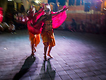 14 JULY 2016 - UBUD, BALI, INDONESIA: Traditional Balinese legong dancers mimic the movements of a bird during a performance at the mass cremation in Ubud. Local people in Ubud exhumed the remains of family members and burned their remains in a mass cremation ceremony Wednesday. Thursday was spent preparing for Saturday's ceremony that concludes the cremation and included traditional Balinese Legong dances performed in the evening. Almost 100 people will be cremated and laid to rest in the largest mass cremation in Bali in years this week. Most of the people on Bali are Hindus. Traditional cremations in Bali are very expensive, so communities usually hold one mass cremation approximately every five years. The cremation in Ubud will conclude Saturday, with a large community ceremony.   PHOTO BY JACK KURTZ