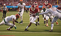 Hawgs Illustrated/BEN GOFF <br /> Devwah Whaley, Arkansas running back, breakst the tackle of Florida A&M defenders Jules Dornevil (13) and Elijah Richardson on his way to a touchdown in the first quarter Thursday, Aug. 31, 2017, during the game at War Memorial Stadium in Little Rock.