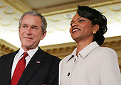 US President George W. Bush and Secretary of State Condoleezza Rice listen as Supreme Court Justice Ruth Bader Ginsberg's remarks during a swearing in ceremony in the Benjamin Franklin Room of the Department of State in Washington, DC Friday 28 January 2005. Secretary Rice, who is the second woman and the first black woman to become Secretary of State, was sworn in by White House chief of staff Andrew Card Wednesday evening, hours after the Senate confirmed her by a vote of 85 to 13,  in a private ceremony at the White House.<br /> Credit: Shawn Thew / Pool via CNP