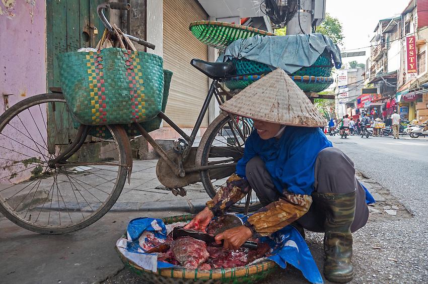 Selling fish in the streets, Street scene in Hanoi, Vietnam
