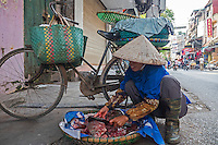 Selling fish in the streets, Street scene in Hanoi, Vietnam