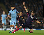 Sergio Aguero of Manchester City jumps over the Sergio Busquets of Barcelona during the Champions League Group C match at the Etihad Stadium, Manchester. Picture date: November 1st, 2016. Pic Simon Bellis/Sportimage