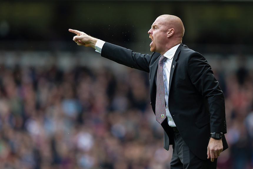 Burnley manager Sean Dyche shouts instructions to his team from the dug-out<br /> <br /> Photographer Craig Mercer/CameraSport<br /> <br /> Football - Barclays Premiership - West Ham United v Burnley - Saturday 2nd May 2015 - Boleyn Ground - London<br /> <br /> &copy; CameraSport - 43 Linden Ave. Countesthorpe. Leicester. England. LE8 5PG - Tel: +44 (0) 116 277 4147 - admin@camerasport.com - www.camerasport.com