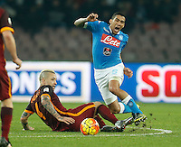 Napoli's Miguel Allan challenged  by  AS Roma's Radja Nainggolan during the  italian serie a soccer match,between SSC Napoli and AS Roma       at  the San  Paolo   stadium in Naples  Italy ,December 13, 2015
