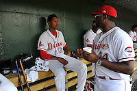 Starting pitcher Anderson Espinoza (39) of the Greenville Drive, left, talks with pitching coach Walter Miranda during his Class A debut in a game against the Savannah Sand Gnats on Saturday, September 5, 2015, at Fluor Field at the West End in Greenville, South Carolina. Espinoza is a 17-year-old from Venezuela. (Tom Priddy/Four Seam Images)
