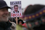 """© Joel Goodman - 07973 332324 . 26/01/2014 . Salford , UK . A woman holds a placard with """" Beware Fracula """" around a photograph of Prime Minister David Cameron . Approximately 500 protesters march to an iGas fracking exploration site at Barton Moss , Salford , today (Sunday 26th January 2014) . They walk along the A57 road , blocking traffic as they do . A long term protest camp has been established on an access road leading to the site and today (26th January) protesters from other areas of the country travelled to the site to join with other protesters against fracking . Photo credit : Joel Goodman"""