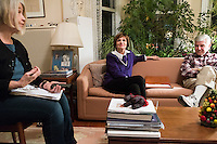 Former Massachusetts governor Michael Dukakis (on couch, right) and his wife Kitty Dukakis (on couch, left) listen as Kate MacDonald (left), of Cambridge, Mass., speaks during support group for people and their family who have had or are thinking about undergoing electroconvulsive therapy (ECT) in their home in Brookline, Massachusetts, USA, on Sun., Dec. 4, 2016. Kitty Dukakis used ECT to treat depression and substance abuse issues. She continues to have ECT treatments about once every seven or eight weeks. MacDonald has also received electroconvulsive treatments.