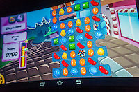 The popular mobile game Candy Crush Saga is seen on the screen of a tablet in New York on Wednesday, February 19, 2014. The maker of the wildly popular game, King Digital Entertainment, has filed for an Initial Public Offering. The game accounts for almost 80 percent of the company's revenue, achieving that from sales of add-ons and upgrades to the free game.  (© Richard B. Levine)