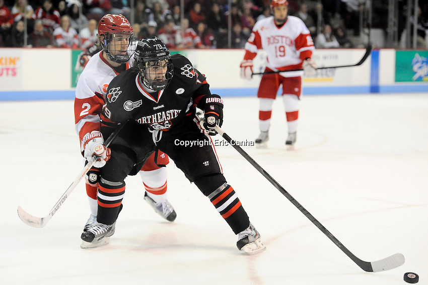 Northeastern University Huskies forward Cody Ferriero (79) and Boston University Terriers defenseman Ryan Ruikka (2) work for the puck in during the second period of the Northeastern University at Boston University NCAA hockey match held at the Agganis Arena in Boston Massachusetts.   Eric Canha/CSM