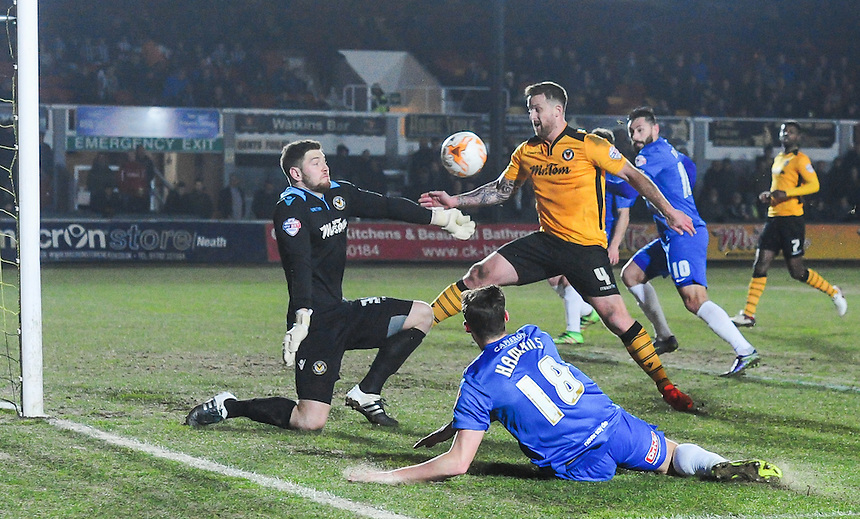 Hartlepool United's Lewis Hawkins shot beaten away by Newport County's Joe Day<br /> <br /> Photographer Craig Thomas/CameraSport<br /> <br /> Football - The Football League Sky Bet League Two - Newport County v Hartlepool United - Tuesday 15th March 2016 - Rodney Parade - Newport<br /> <br /> &copy; CameraSport - 43 Linden Ave. Countesthorpe. Leicester. England. LE8 5PG - Tel: +44 (0) 116 277 4147 - admin@camerasport.com - www.camerasport.com