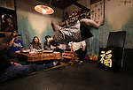 """October 22, 2016, Utsunomiya, Japan - A Japanese macaque Fuku (meaning happiness) makes a somersault before guests at an izakaya, Japanese pub """"Kayabuki"""" in Utsunomiya, 100km north of Tokyo on Saturday, October 22, 2016. The pub master Kaoru Otsuka trains Japanese macaques to help him and show their entertainment skills to attract customers including lots of foreign tourists.   (Photo by Yoshio Tsunoda/AFLO) LWX -ytd-"""