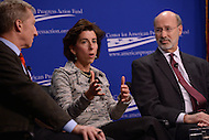 Washington, DC - February 19, 2016: Gov. Gina Raimondo of Rhode Island participates in a panel discussion on climate and clean energy at the Center for American Progress in the District of Columbia, February 19, 2016, as Tom Steyer, founder of NextGen Climate and Gov. Tom Wolf of Pennsylvania look on. (Photo by Don Baxter/Media Images International)