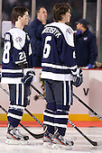 Grayson Downing (UNH - 28), Trevor van Riemsdyk (UNH - 6) - The University of Maine Black Bears defeated the University of New Hampshire Wildcats 5-4 in overtime on Saturday, January 7, 2012, at Fenway Park in Boston, Massachusetts.