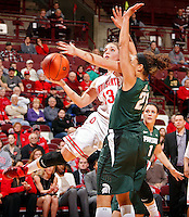 Ohio State Buckeyes guard Cait Craft (13) gets fouled by Michigan State Spartans guard Klarissa Bell (21) while going up for a basket during the second half of their NCAA basketball game at Value City Arena in Columbus, Ohio on January 26, 2014.  (Dispatch photo by Kyle Robertson)