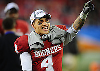 Jan. 1, 2011; Glendale, AZ, USA; Oklahoma Sooners wide receiver (4) Kenny Stills celebrates following the game against the Connecticut Huskies in the 2011 Fiesta Bowl at University of Phoenix Stadium. The Sooners defeated the Huskies 48-20. Mandatory Credit: Mark J. Rebilas-