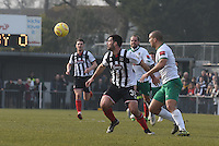 Pat Hoban of Grimsby Town is challenged by Sami El-Abd of Bognor Regis Town during the FA Trophy Semi Final first leg match between Bognor Regis and Grimsby Town at Nyewood Lane, Bognor Regis, England on 12 March 2016. Photo by Paul Paxford/PRiME Media Images.