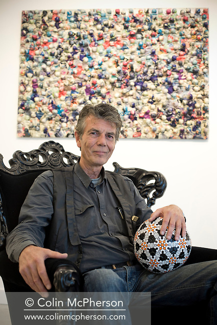 Renowned Dutch artist Bob van Persie, photographed in front of one of his pictures and bouncing a printed football he designed entitled 'Persie Ball, 2010' at the Richard Goodall Gallery in Manchester, where his latest exhibition is about to open. Bob van Persie is the father of the Manchester United and Netherlands footballer Robin. The show, entitled 'One Man - Full House,' was due to open on 12th September and continue until 5th October.