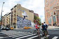 New York, NY - 8 August 2015 - Mural by street artist JR adorns the side of  a TriBeCa loft building in Lower Manhattan