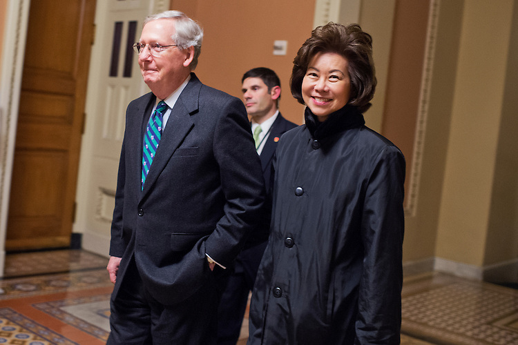 UNITED STATES - JANUARY 12: Senate Majority Leader Mitch McConnell, R-Ky., and his wife Elaine Chao, former Secretary of Labor, are pictured in the Capitol before President Obama's State of the Union address, January 12, 2016. (Photo By Tom Williams/CQ Roll Call)