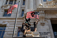 Protesters raise a flag bearing a Black power insignia outside of D.C. mayor Muriel Bowserís office during a march against police brutality and racism in Washington, D.C. on Saturday, June 6, 2020.<br /> Credit: Amanda Andrade-Rhoades / CNP/AdMedia