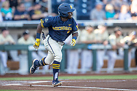 Michigan Wolverines second baseman Ako Thomas (4) runs to first base against the Vanderbilt Commodores during Game 3 of the NCAA College World Series Finals on June 26, 2019 at TD Ameritrade Park in Omaha, Nebraska. Vanderbilt defeated Michigan 8-2 to win the National Championship. (Andrew Woolley/Four Seam Images)