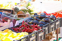 Yellow bell pepper, red pepperoni, egg plants eggplants aubergine, in baskets. In the fruit and vegetable market in the harbour. Luka Gruz harbour. Dubrovnik, new city. Dalmatian Coast, Croatia, Europe.